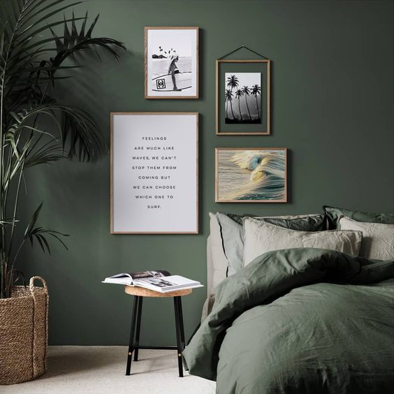 green accent wall and gallery wall