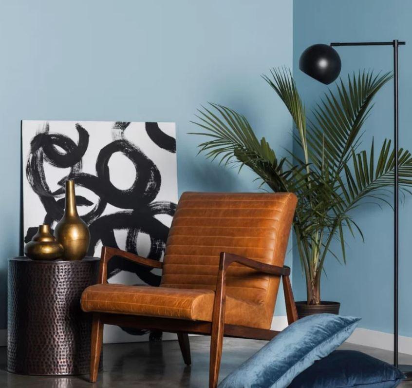Kentia palm tree and Cedarburg chair.