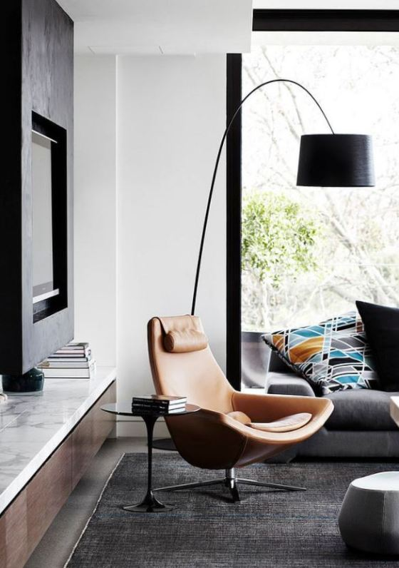Arc floor lamp and leaning chair