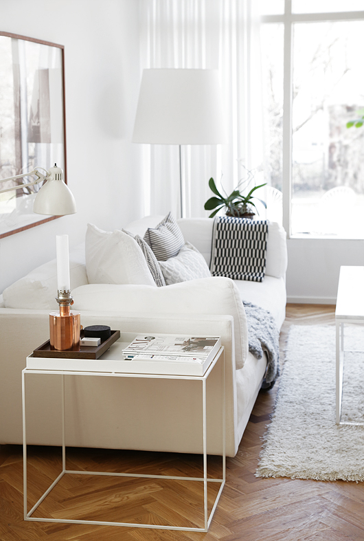 white living room with white couch, white walls and white couch